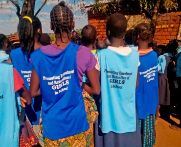 Mankhwangwe Girls Wearing bibs donated by RFF as they make a game plan.