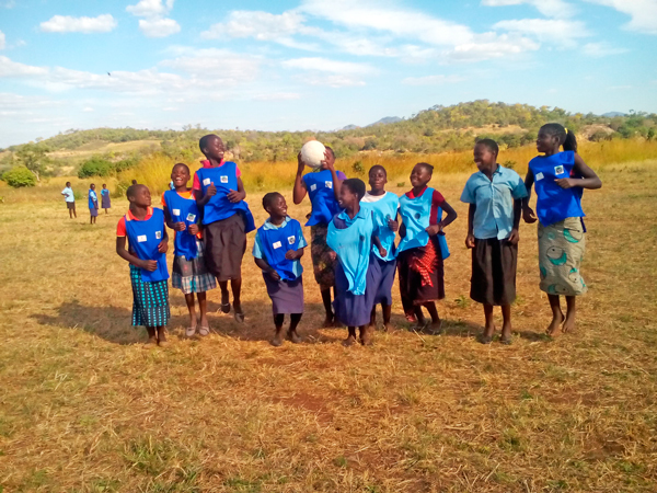 The GAF members expressed their gratitude and happiness by trying out the bibs, and playing soccer and netball within the school playgrounds.