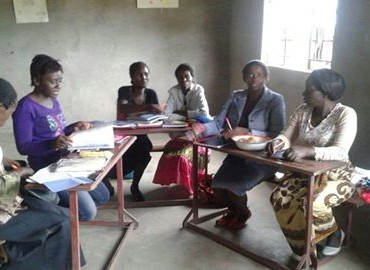 Field Assistant Enless Daka during a development session for the Girls Action Forum mentors at Chitendela Community School